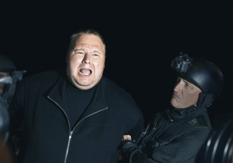 Kim Dotcom reenacts the police raid on his Coatesville mansion at the launch of Mega. Photo by Nigel Marple.