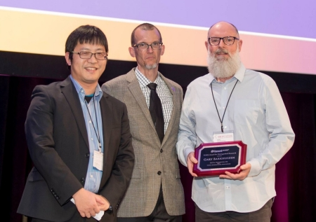 Dr Andy Gao and Dr Dudley Reynolds present Gary with the the 2017 Award for Distinguished Research from the TESOL International Association.