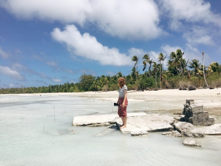 Devon standing on what used to be a petrol station in a now-abandoned village in Abaiang, Kiribati