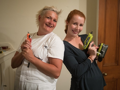 Host Brigid Gallagher and on-screen researcher Justine Treadwell pose with tools as they revitalise the Pahiatua Museum.