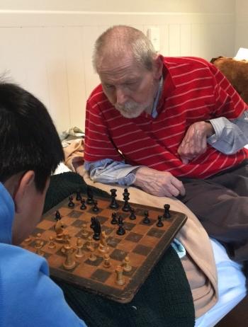 Dr Milan Kalous playing chess