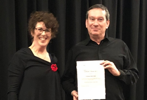 Martin East receives the FIPLV 2017 International Award from NZALT President Annabelle Sinclair